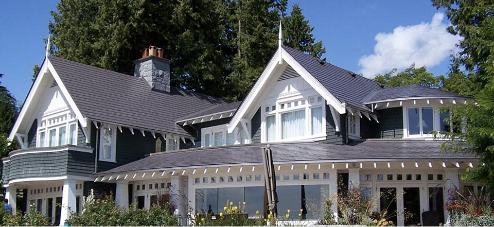 Roofing choosing the right materials design custom homes for Images of houses with metal roofs